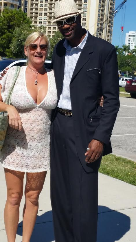 On the tour with customers Real Estate Broker Mr. Phillip Miller takes a picture with lady who lives in Sarasota Florida.