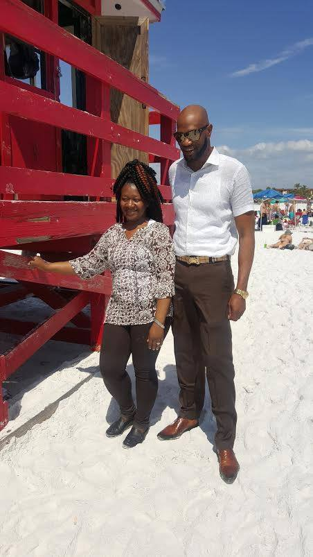 My customer and I . We are at Siesta Key Beach .