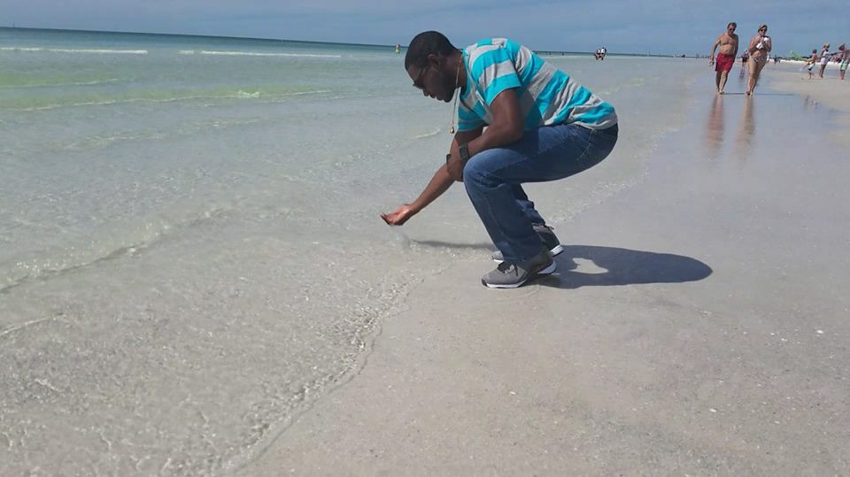 One of my customers loving the sand and clear water at Crystal Sands on Siesta Key Siesta Key Beach in Sarasota Florida named one of the best Beches in America.
