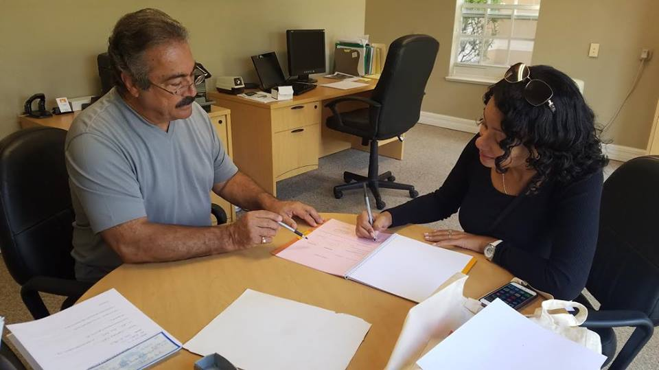 My customer signing her contract purchasing her quarter acre land in Sarasota Florida and in a couple of years Deltona will build her very own home..