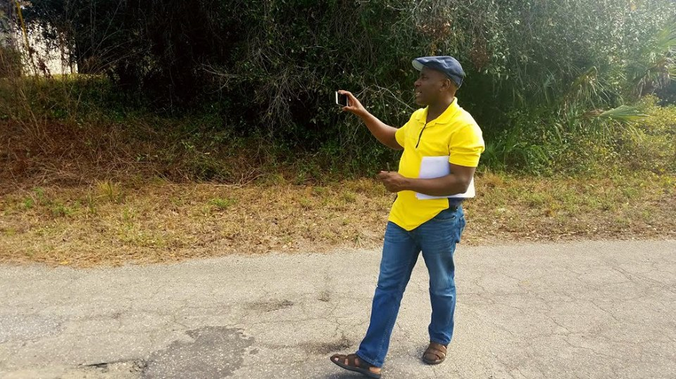 My customer picking and taking a picture of the land that he is buying in Sarasota Florida.