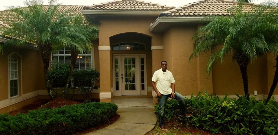 My customer that I brought to Sarasota Florida in front of Deltona's model house that we show customers when theuy come down to Sarasota to check out the area and lifestyle.