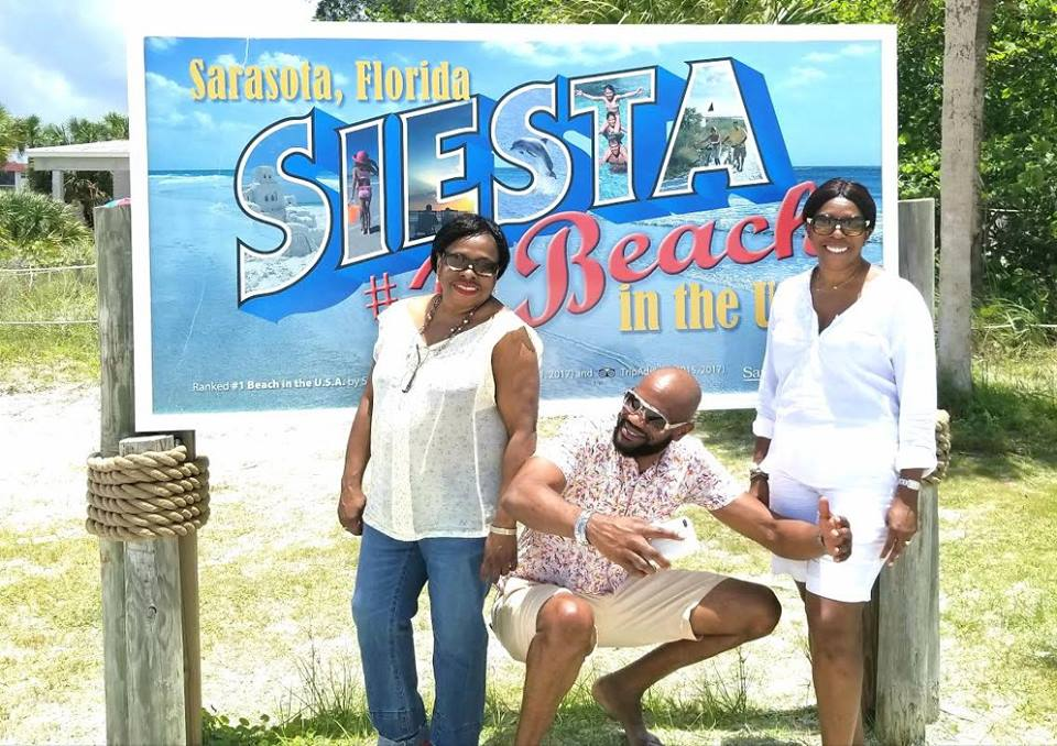 With my customers at Siesta Key Beach in Sarasota showing them the area .